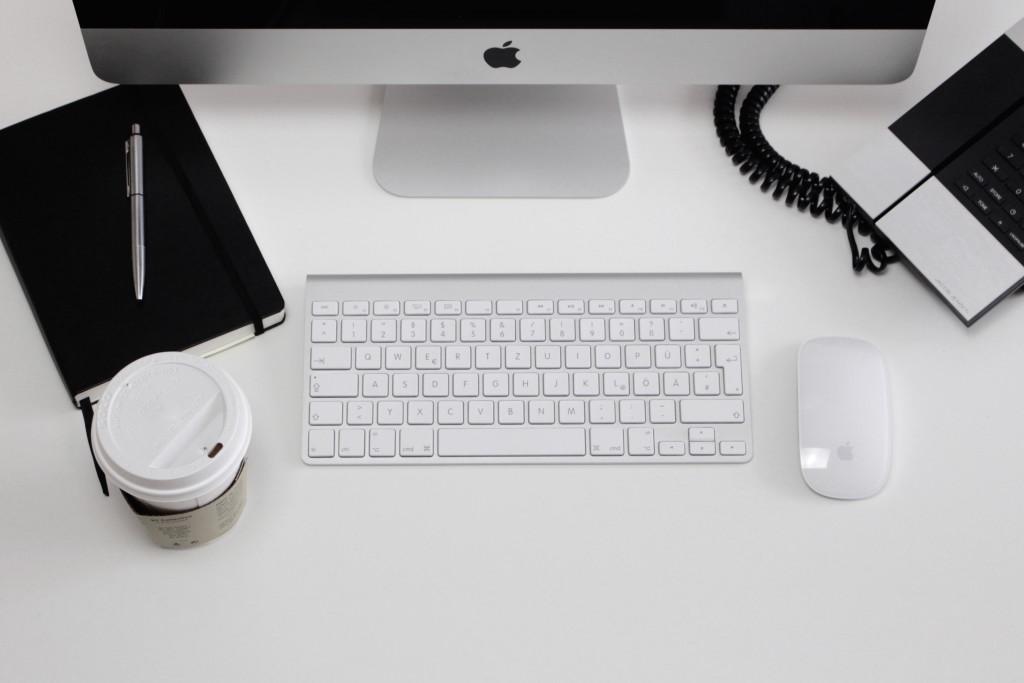imac, phone, keyboard, mouse, coffee, notebook