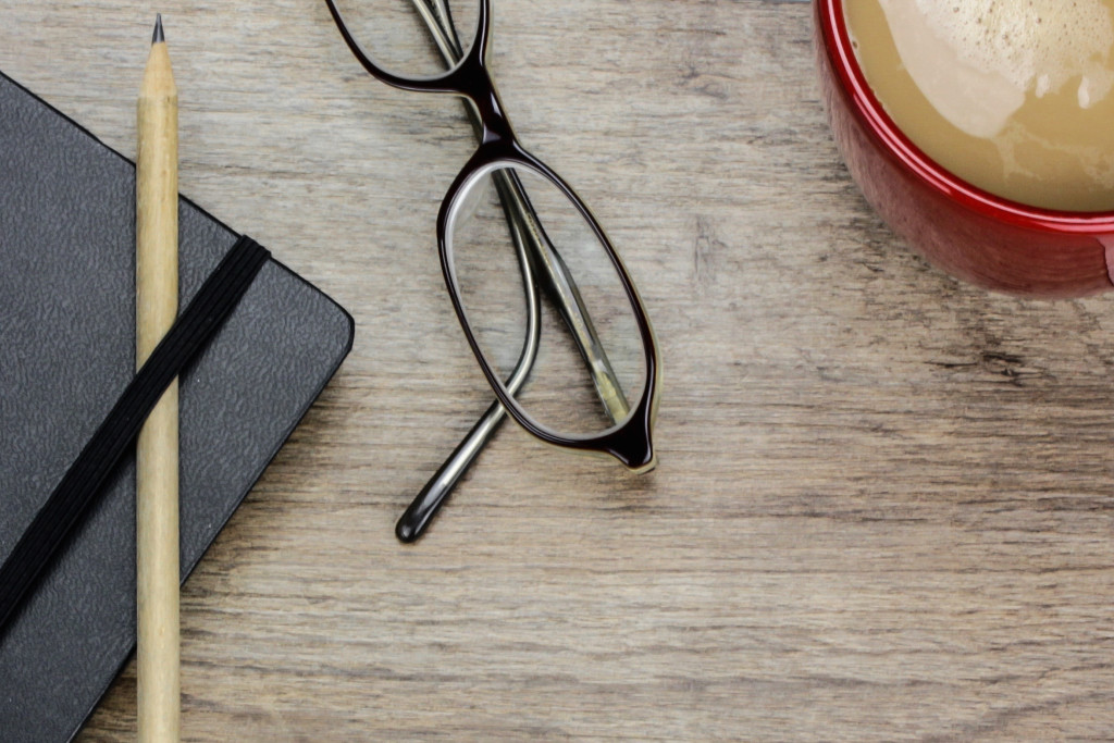 glasses, notebook, coffee, pencil