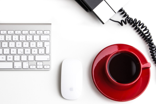 desk, coffee, phone, mouse, keyboard, red cup