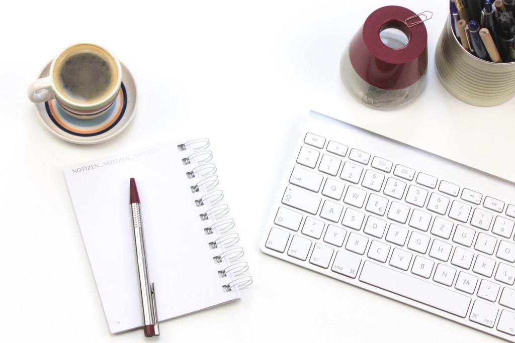 desk, notepad, keyboard, espresso, pens, paperclip